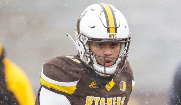 Nov 17, 2018; Laramie, WY, USA; Wyoming Cowboys quarterback Sean Chambers (12) warms up before game against the Air Force Falcons at Jonah Field War Memorial Stadium. Photo Credit: Troy Babbitt-USA TODAY Sports