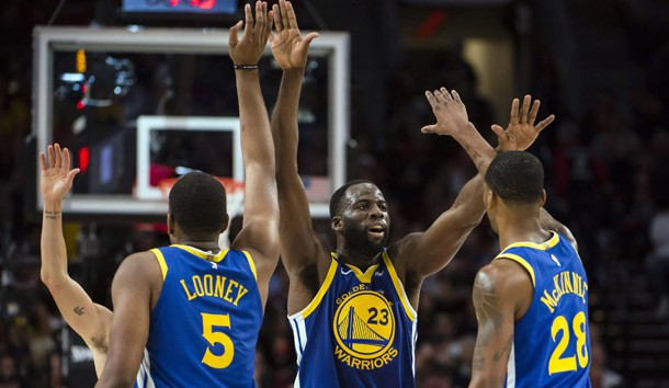 May 18, 2019; Portland, OR, USA; Golden State Warriors forward Draymond Green (23) gives high-fives to teammates center Kevon Looney (5) and forward Alfonzo McKinnie (28) during the second half in game three of the Western conference finals of the 2019 NBA Playoffs at Moda Center. The Golden State Warriors beat the Portland Trail Blazers 110-99. Photo Credit: Troy Wayrynen-USA TODAY Sports