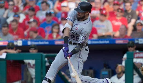 May 18, 2019; Philadelphia, PA, USA; Colorado Rockies left fielder David Dahl (26) hits a single during the seventh inning against the Philadelphia Phillies at Citizens Bank Park. Photo Credit: Bill Streicher-USA TODAY Sports