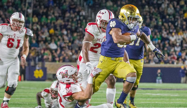 Sep 30, 2017; South Bend, IN, USA; Notre Dame Fighting Irish running back Deon McIntosh (38) runs out of the tackle of Miami (Oh) Redhawks defensive back Matt Merimee (22) in the second half of the game at Notre Dame Stadium. Photo Credit: Trevor Ruszkowski-USA TODAY Sports