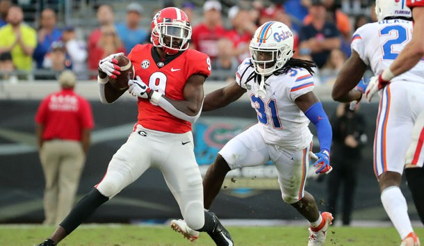 Oct 27, 2018; Jacksonville, FL, USA; Georgia Bulldogs wide receiver Jeremiah Holloman (9) catches the ball against Florida Gators defensive back Shawn Davis (31) during the second half at TIAA Bank Field. Photo Credit: Kim Klement-USA TODAY Sports