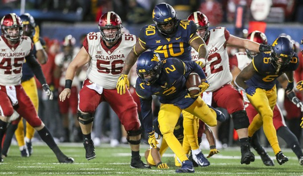 Nov 23, 2018; Morgantown, WV, USA; West Virginia Mountaineers safety Kenny Robinson Jr. (2) recovers a fumble during the second quarter against the Oklahoma Sooners at Mountaineer Field at Milan Puskar Stadium. Photo Credit: Ben Queen-USA TODAY Sports