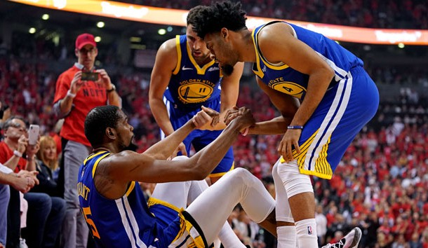 Jun 10, 2019; Toronto, Ontario, CAN; Golden State Warriors forward Kevin Durant (35) is helped up by guard Quinn Cook (4) and guard Klay Thompson (11) after an apparent injury during the second quarter in game five of the 2019 NBA Finals against the Toronto Raptors at Scotiabank Arena. Photo Credit: Kyle Terada-USA TODAY Sports
