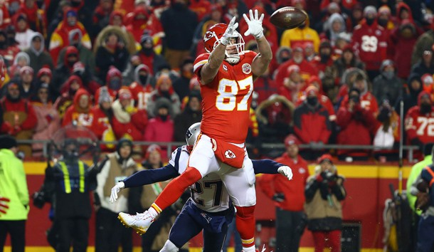 Jan 20, 2019; Kansas City, MO, USA; Kansas City Chiefs tight end Travis Kelce (87) catches the ball in front of New England Patriots defensive back J.C. Jackson (27) during the second half of the AFC Championship game at Arrowhead Stadium. Photo Credit: Jay Biggerstaff-USA TODAY Sports