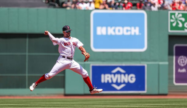 Jun 23, 2019; Boston, MA, USA; Boston Red Sox shortstop Xander Bogaerts (2) throws to first during the first inning against the Toronto Blue Jays at Fenway Park. Photo Credit: Paul Rutherford-USA TODAY Sports