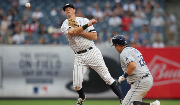 Jul 18, 2019; Bronx, NY, USA; New York Yankees second baseman DJ LeMahieu (26) forces out Tampa Bay Rays first baseman Ji-Man Choi (26) and throws to first base on a ball hit by Tampa Bay Rays catcher Travis d'Arnaud (not pictured) during the seventh inning of the first game of a doubleheader at Yankee Stadium. The throw by LeMahieu was not in time to complete a double play. Photo Credit: Brad Penner-USA TODAY Sports
