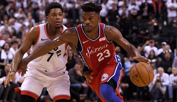 May 12, 2019; Toronto, Ontario, CAN;   Philadelphia 76ers guard Jimmy Butler (23) dribbles the ball against Toronto Raptors guard Kyle Lowry (7) in game seven of the second round of the 2019 NBA Playoffs at Scotiabank Arena. Photo Credit: Dan Hamilton-USA TODAY Sports