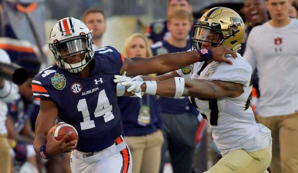 Dec 28, 2018; Nashville, TN, USA; Auburn Tigers quarterback Malik Willis (14) rushes against the Purdue Boilermakers during the second half of the 2018 Music City Bowl at Nissan Stadium. Auburn won 63-14. Mandatory Credit: Jim Brown-USA TODAY Sports