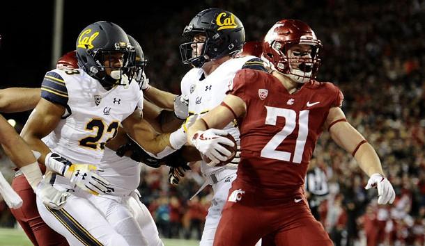 Nov 3, 2018; Pullman, WA, USA; Washington State Cougars running back Max Borghi (21) scores a touchdown against California Golden Bears linebacker Malik Psalms (23) in the first half at Martin Stadium. Photo Credit: James Snook-USA TODAY Sports