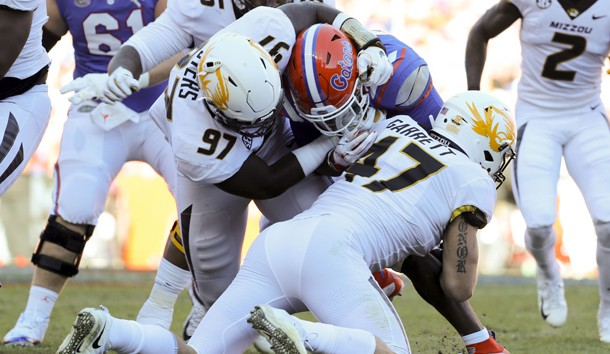 Nov 3, 2018; Gainesville, FL, USA; Missouri Tigers linebacker Cale Garrett (47) and Missouri Tigers defensive lineman Akial Byers (97) tackle Florida Gators running back Lamical Perine (22) during the first quarter at Ben Hill Griffin Stadium. Photo Credit: Kim Klement-USA TODAY Sports