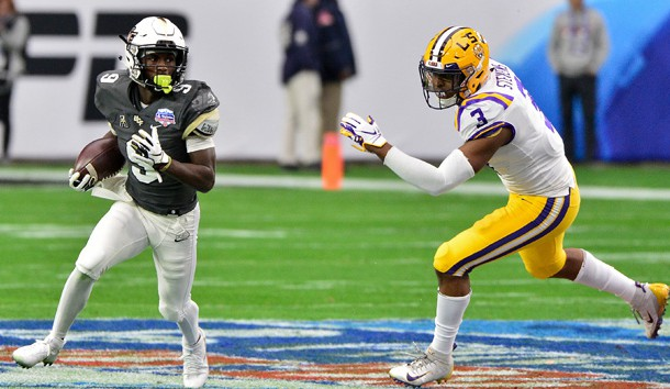 Jan 1, 2019; Glendale, AZ, USA; UCF Knights running back Adrian Killins Jr. (9) runs the ball as LSU Tigers safety JaCoby Stevens (3) chases during the first half during the 2019 Fiesta Bowl at State Farm Stadium. Photo Credit: Matt Kartozian-USA TODAY Sports