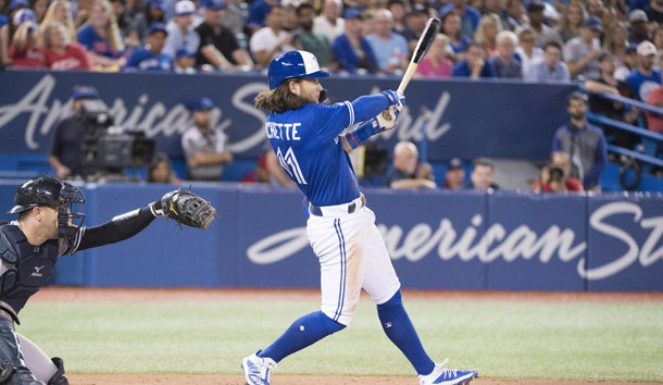 Aug 8, 2019; Toronto, Ontario, CAN;Toronto Blue Jays shortstop Bo Bichette (11) hits an RBI double during the sixth inning against the New York Yankees at Rogers Centre. Photo Credit: Nick Turchiaro-USA TODAY Sports