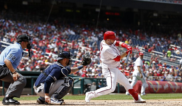 Aug 18, 2019; Washington, DC, USA; Washington Nationals second baseman Brian Dozier (9) hits a three run home run against the Milwaukee Brewers in the third inning at Nationals Park. Photo Credit: Geoff Burke-USA TODAY Sports