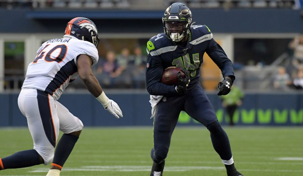 Aug 8, 2019; Seattle, WA, USA; Seattle Seahawks wide receiver D.K. Metcalf (14) runs the ball against Denver Broncos linebacker Keishawn Bierria (40) in the first half at CenturyLink Field.   Photo Credit: Kirby Lee-USA TODAY Sports