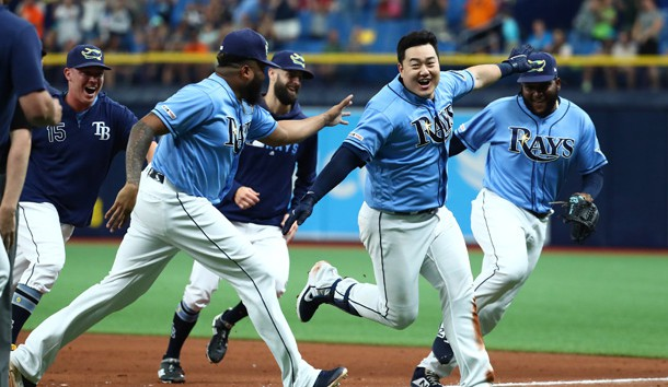 Aug 18, 2019; St. Petersburg, FL, USA;Tampa Bay Rays first baseman Ji-Man Choi (26) celebrates with relief pitcher Jose Alvarado (46), relief pitcher Diego Castillo (63) and teammates as he hit the game winning walk off two-RBI single during the ninth inning to beat the Detroit Tigers  at Tropicana Field. Photo Credit: Kim Klement-USA TODAY Sports