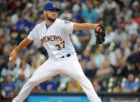 Surging Brewers try to stay in playoff chase vs. Padres