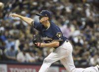 Brewers flying high, eyeing division title in Denver