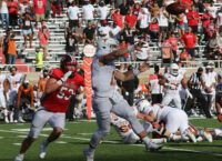 Moore's Third Scoring Catch Saves 'Horns in Overtime