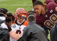 Bengals rookie QB Burrow carted off with injury