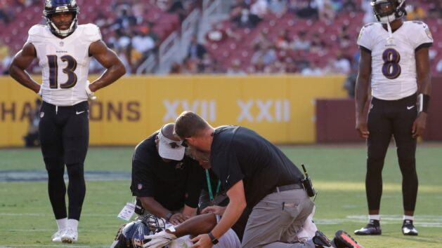 Ravens RB J.K. Dobbins carted off with knee injury