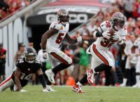 Brady, Edwards Drive Bucs Past Stubborn Falcons